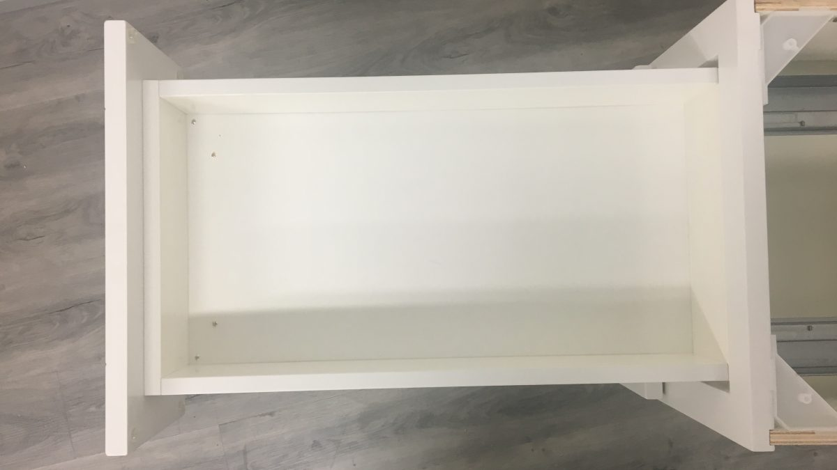 Irvine White Shaker (BOC): Painted drawer box, thick door finish but warped panels