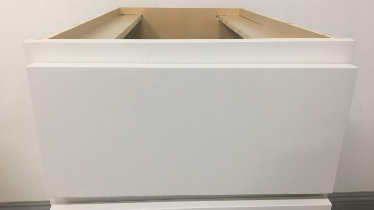 Kitchen Cabinet Distributors: chaotic assembly, damaged packaging, but wrapped door and frame